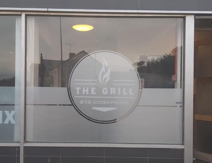 The Grill Shop Front and Sign